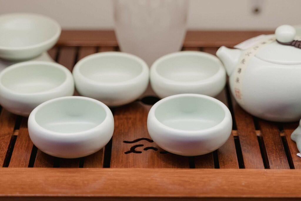Japanese ceramics beautifully arranged on a wooden tray.
