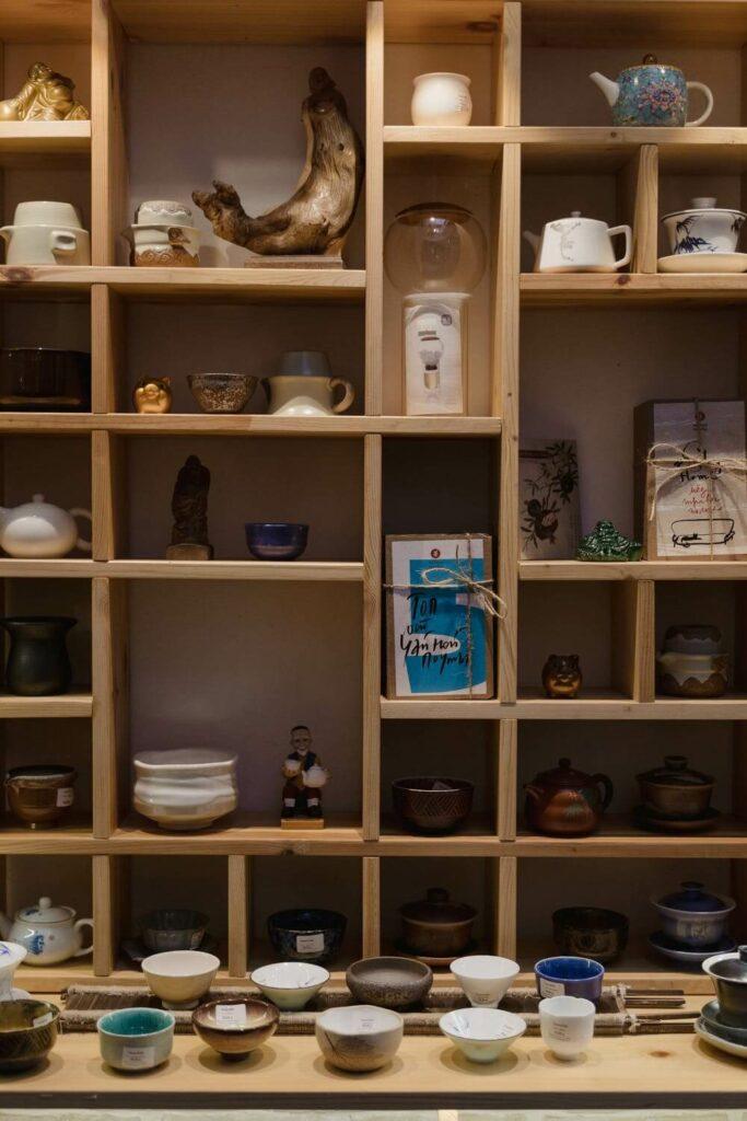 A shelf full of Japanese ceramics.