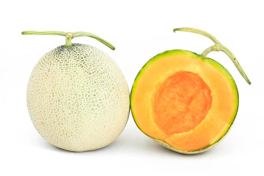 A bright orange Yubari melon from Hokkaido.