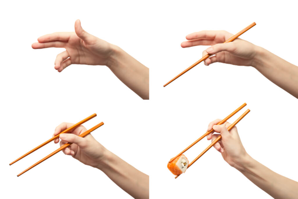 A guide to holding chopsticks with a hand in four different positions, going from holding nothing to holding two chopsticks and a salmon roll