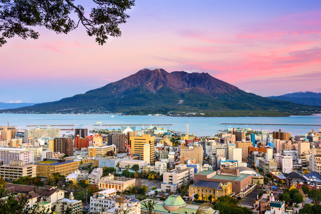 A view of a city in Kyushu with Kagoshima, an island with some of the best hiking trails in Kyushu, across the water